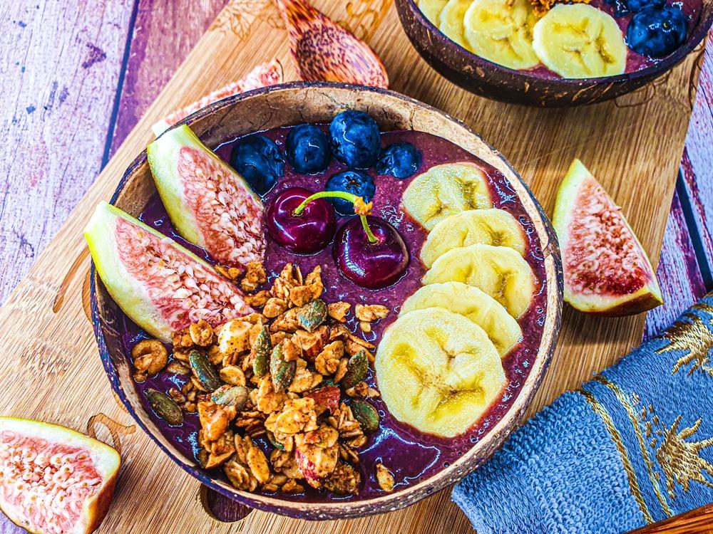 Vegan Recipes Cacao-Shamaness Vegan Acai Smoothie Bowl with Fresh Fruits, Homemade Granola, and Organic Peanut Butter.