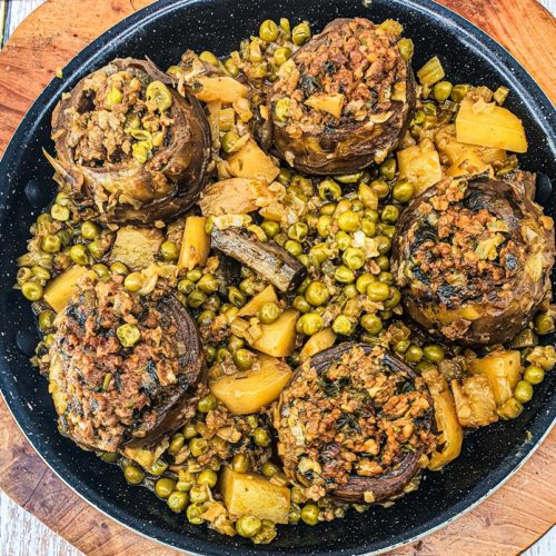 Vegan Recipes Cacao-Shamaness Vegan Stuffed Artichokes Stew with Potatoes and Peas